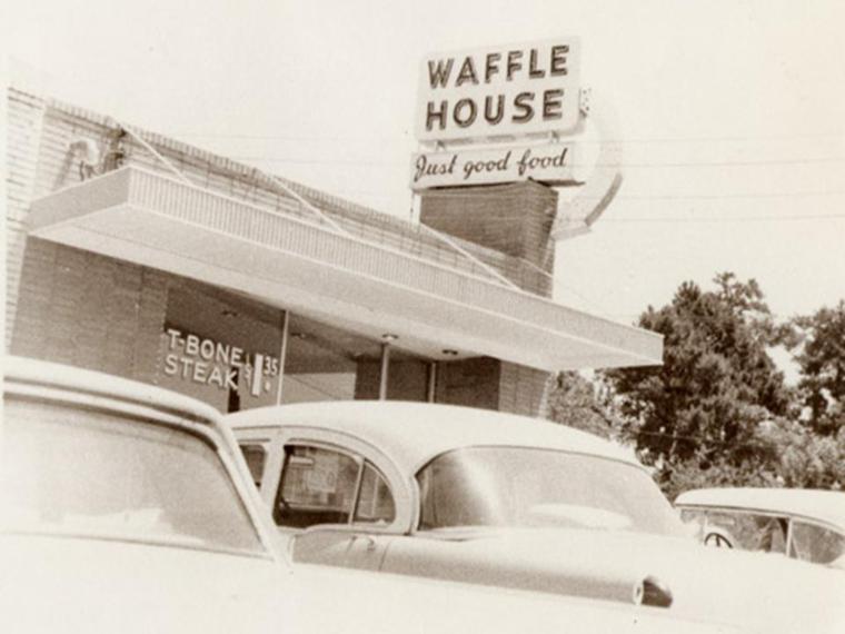 Vintage black and white photo of original Waffle House sign