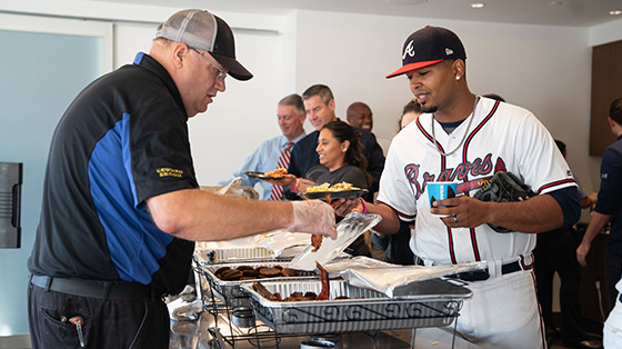 Atlanta Braves player being served at Waffle House event