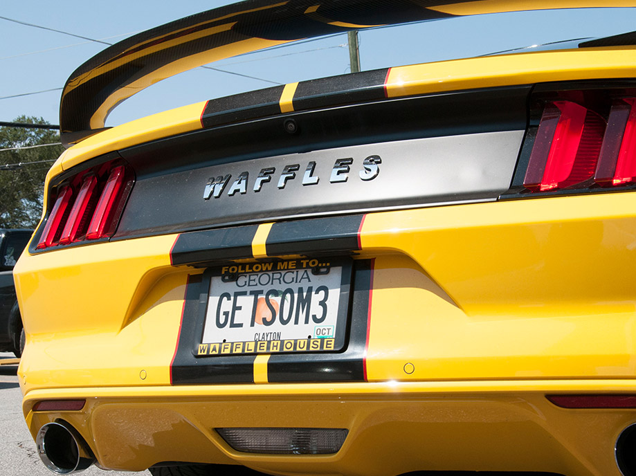 Ford mustang with custom Waffles signage